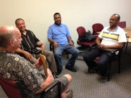Volunteers debrief a restorative conference